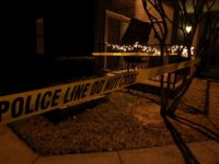 GRAPEVINE, TX - DECEMBER 25: Police line tape surrounds an apartment building where seven people were found dead at Lincoln Vineyard Apartment Homes on December 25, 2011 in Grapevine, Texas. (Photo by Ronald Martinez/Getty Images)