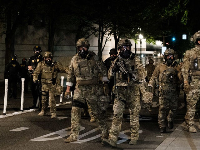 PORTLAND, OR - JULY 17: Federal officers prepare to disperse the crowd of protestors outside the Multnomah County Justice Center on July 17, 2020 in Portland, Oregon. Federal law enforcement agencies attempt to intervene as protests continue in Portland. (Photo by Mason Trinca/Getty Images)