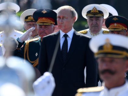 Russian President Vladimir Putin attends the Navy Day parade in Saint Petersburg on July 29, 2018. (Photo by Kirill KUDRYAVTSEV / AFP) (Photo credit should read KIRILL KUDRYAVTSEV/AFP via Getty Images)