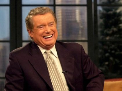 """**FILE**Host Regis Philbin shares a laugh with co-host Kelly Ripa during a broadcast of """"Live with Regis and Kelly"""" on Feb. 5, 2001, in New York. Philbin, in a telephone call to the show Monday, April 16, 2007, said he plans to return to his syndicated talk show April 26, …"""