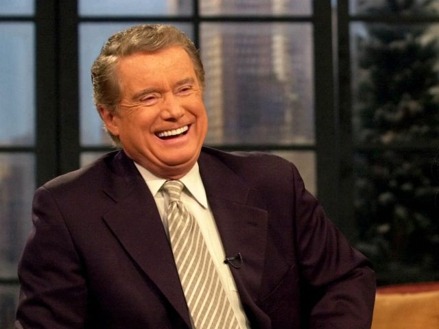 "**FILE**Host Regis Philbin shares a laugh with co-host Kelly Ripa during a broadcast of ""Live with Regis and Kelly"" on Feb. 5, 2001, in New York. Philbin, in a telephone call to the show Monday, April 16, 2007, said he plans to return to his syndicated talk show April 26, …"