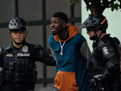 SEATTLE, WA - JULY 01: Police detain a person as city crews dismantle the Capitol Hill Organized Protest (CHOP) area outside of the Seattle Police Department's vacated East Precinct on July 1, 2020 in Seattle, Washington. Police reported making at least 31 arrests while clearing the CHOP area this morning. …