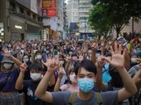 "Protesters against the new national security law gesture with five fingers, signifying the ""Five demands - not one less"" on the anniversary of Hong Kong's handover to China from Britain in Hong Kong, Wednesday, July. 1, 2020. Hong Kong marked the 23rd anniversary of its handover to China in 1997, …"