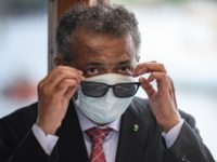 "World Health Organization (WHO) Director-General Tedros Adhanom Ghebreyesus wears a mask after leaving a ceremony of the restarting of Geneva's landmark fountain, known as ""Jet d'Eau"" following the COVID-19 outbreak, caused by the novel coronavirus on June 11, 2020 in Geneva. - The fountain was switched off on March 20, …"