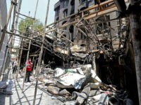 Iranian security and rescue staff work at the site of an explosion at the Sina At'har health centre in the upmarket northern neighbourhood of Tajrish in the capital Tehran on July 1, 2020. - Iranian police questioned four people as part of investigations into a powerful explosion that killed 19 …