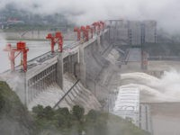 This picture taken on June 29, 2020 shows water being released from the Three Gorges Dam, a gigantic hydropower project on the Yangtze river, in Yichang, central China's Hubei province. - The Three Gorges Dam released water for the first time this year, as a preparation of the upcoming annual …