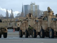 Military personnel unload Bradley Infantry Fighting tanks of the 2nd Brigade Combat Team, 3rd Infantry Division, as US military equipment arrives to the Port of Bremerhaven the United States for the Defender 2020 international military exercises on February 21, 2020. - Exercise DEFENDER-Europe 20 is a US-led multinational exercise, including …