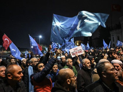 Supporters of China's Muslim Uighur minority wave flags of East Turkestan on December 20, 2019 during a demostration at Fatih in Istanbul. - More than 1,000 protesters marched on December 20, 2019, in Istanbul to protest against China over its treatment of mainly Muslim Uighurs in Xinjiang, an AFP correspondent …