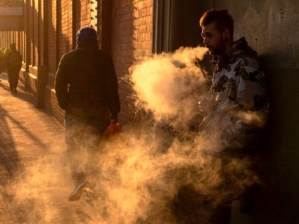 A man exhales a cloud off vapours as he smokes an electronic vaping machine outside Waterloo station in London on December 27,2018. (Photo by NIKLAS HALLE'N / AFP) (Photo credit should read NIKLAS HALLE'N/AFP via Getty Images)