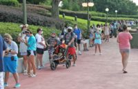 Disney World reopens as WHO urges virus caution
