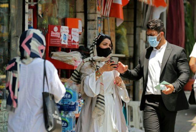 Iran says virus death toll tops 13,000