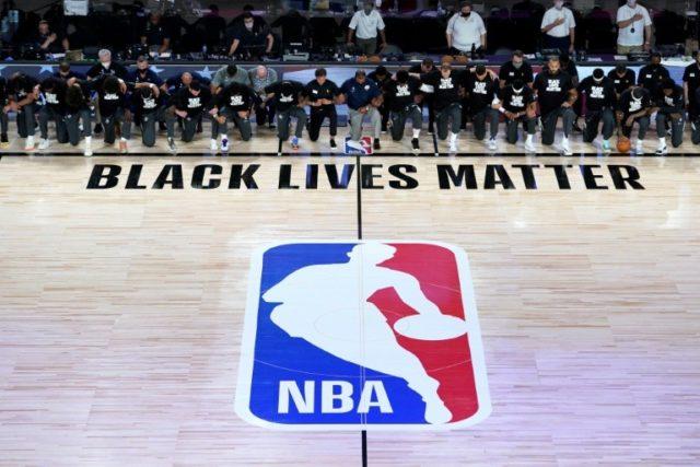 Players kneel during anthem as NBA restarts in Florida