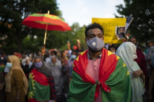 In this Wednesday, July 1, 2020 file photo, protesters outraged by the killing of popular Ethiopian singer Hachalu Hundessa walk along Lexington Avenue after exiting off westbound Interstate 94, in St. Paul, Minn. Ethiopian officials said Wednesday, July 8, 2020 that at least 239 people have been killed and 3,500 …