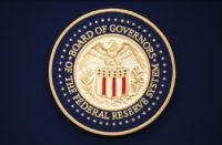 This July 31, 2019, file photo, shows the Federal Reserve logo ahead of the start of a scheduled news conference by Chairman Jerome Powell in Washington. The Federal Reserve says it purchased $1.3 billion in corporate bonds in late June 2020 as part of its effort to keep U.S. interest …
