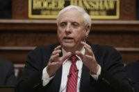 In this Jan. 8, 2020, file photo, West Virginia Gov. Jim Justice delivers his annual State of the State address in the House Chambers at the state capitol in Charleston, W.Va. The former West Virginia public health leader forced out by the governor says decades-old computer systems and cuts to …