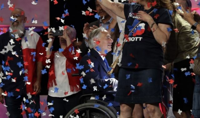 In this June 15, 2018 file photo, Confetti falls as Texas Gov. Greg Abbott, center, greets supporters after speaking at the Texas GOP Convention, in San Antonio. The Texas Supreme Court has upheld Houston's refusal to allow the state Republican convention to hold in-person events in the city due to …