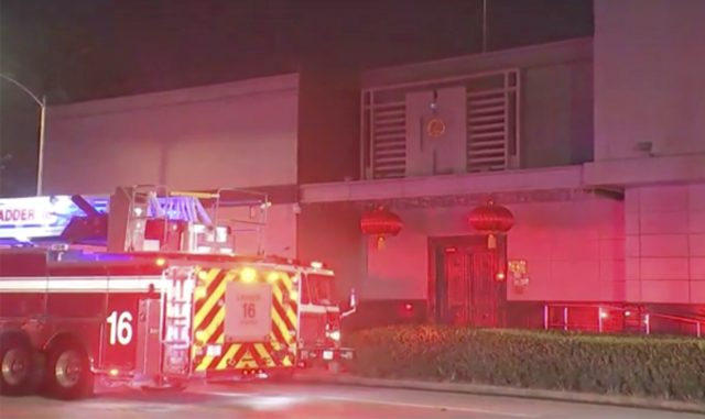 In this image made from video, fire engine is seen outside Chinese consulate in Houston, Tuesday, July 21, 2020. Media reports in Houston said that authorities had responded to reports of a fire at the consulate. Witnesses said that people were burning paper in what appeared to be trash cans, …