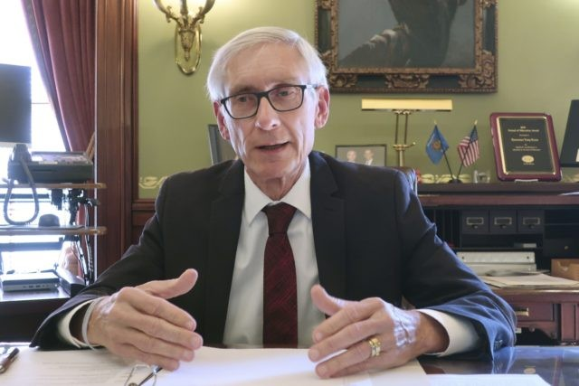 In this Dec. 4, 2019 file photo, Wisconsin Gov. Tony Evers speaks in his Statehouse office in Madison, Wis. Gov. Evers on Thursday, July 30, 2020, issued a statewide mask mandate amid a spike in coronavirus cases, setting up a conflict with Republican legislative leaders who oppose such a requirement …