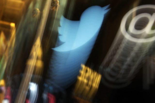 In this Wednesday Nov. 6, 2013, file photo, the Twitter logo appears on an updated phone post on the floor of the New York Stock Exchange. Twitter says the hackers responsible for a recent high-profile breach used the phone to fool the social media company's employees into giving them access. …