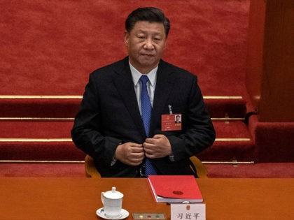 BEIJING, CHINA - MAY 28: Chinese president Xi Jinping listens during the closing session of the National People's Congress, which included a vote on a new draft security bill for Hong Kong, at the Great Hall of the People on May 28, 2020 in Beijing, China. The Chinese government passed …