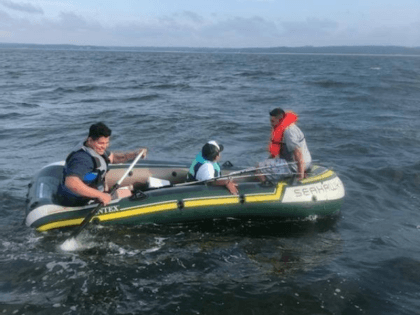 Three men in a blow-up boat stranded in the Long Island Sound in New York were rescued by the police and are back on dry land.
