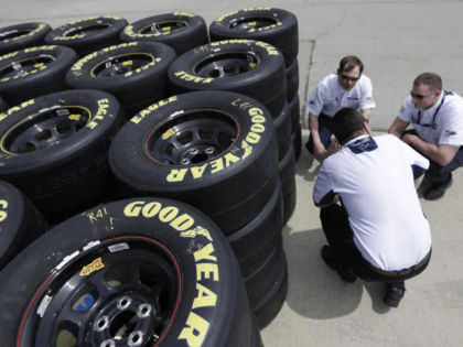In this April 3, 2014 file photo, Goodyear tire technical officials discuss tires at the Texas Motor Speedway in Fort Worth, Texas. Goodyear reports quarterly financial results on Wednesday, July 29, 2015. (AP Photo/LM Otero, File)