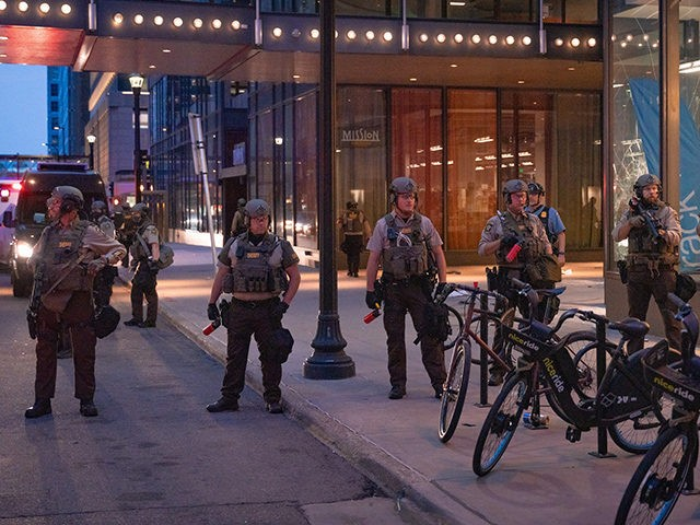 Hennepin County Sheriffs Officers patrol outside the Norstrom Rack and IDS Center in Minneapolis after looting and vandalism on August 27th, 2020.