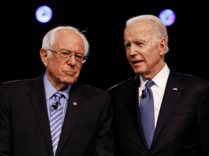 In this Feb. 25, 2020 file photo, Democratic presidential candidates, Sen. Bernie Sanders, I-Vt., left, and former Vice President Joe Biden, talk before a Democratic presidential primary debate in Charleston, S.C. Political task forces Biden formed with Sanders to solidify support among the Democratic Party's progressive wing recommended Wednesday, July …