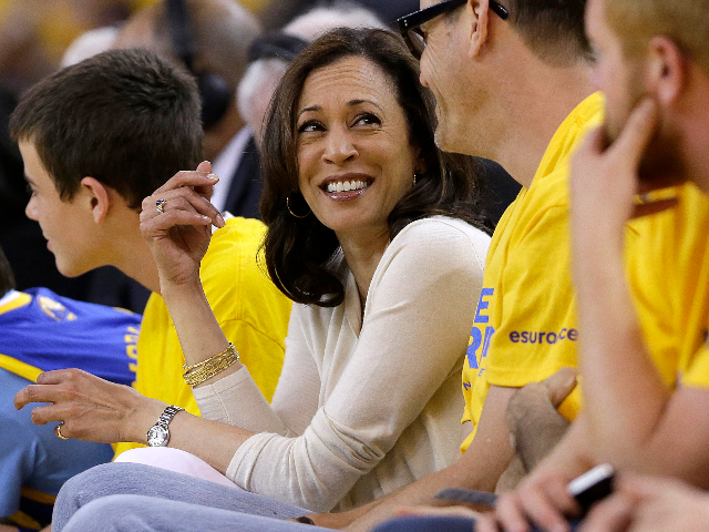 Attorney General of California Kamala Harris during Game 4 of a Western Conference semifinal NBA basketball playoff series between the Golden State Warriors and the San Antonio Spurs in Oakland, Calif., Sunday, May 12, 2013. (AP Photo/Jeff Chiu)