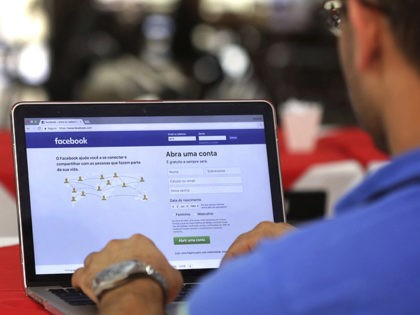 FILE - In this Thursday, Jan. 4, 2018, file photo, a man enters his Facebook page, at a restaurant in Brasilia, Brazil. Federal prosecutors in Latin America's biggest country have opened an investigation to determine if Cambridge Analytica illegally used the profiles of millions of Brazilian Facebook users. (AP Photo/Eraldo …