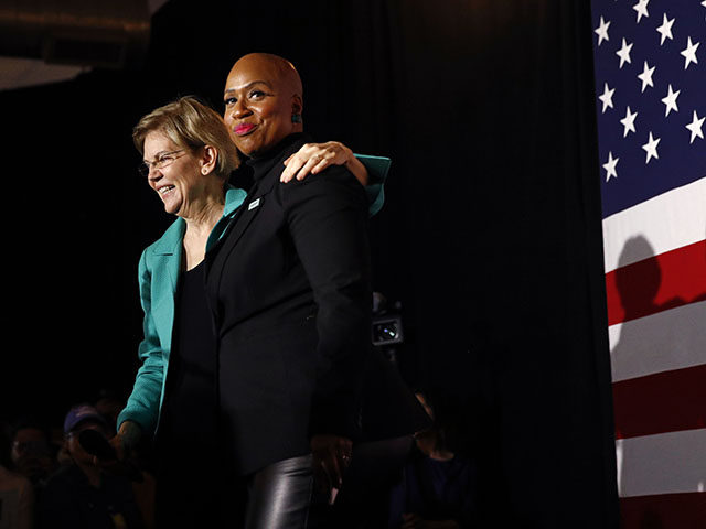 Democratic presidential candidate Sen. Elizabeth Warren, D-Mass., left, stands onstage with Rep. Ayanna Pressley, D-Mass., before speaking at a campaign event, Monday, Feb. 24, 2020, in Charleston, S.C. (AP Photo/Patrick Semansky)