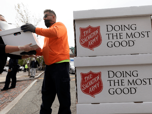 People distribute food donated by the Salvation Army, Friday, May 8, 2020, in Chelsea, Mass. (AP Photo/Michael Dwyer)
