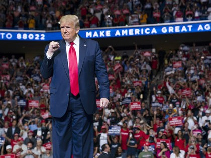 President Donald Trump arrives on stage to speak at a campaign rally at the BOK Center, Saturday, June 20, 2020, in Tulsa, Okla. Trump is asking Americans to let him keep his job. His critics are asking how much of that job he's actually doing. Those questions have gotten louder …