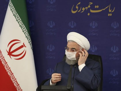 In this photo released by the official website of the office of the Iranian Presidency, President Hassan Rouhani adjusts his face mask in a meeting of the national headquarters of the fight against the COVID-19, in Tehran, Iran, Saturday, July 18, 2020. He estimated as many as 25 million Iranians …