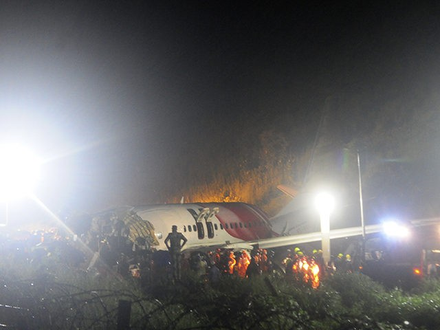 The Air India Express flight that skidded off a runway while landing at the airport in Kozhikode, Kerala state, India, Friday, Aug. 7, 2020. The special evacuation flight bringing people home to India who had been trapped abroad because of the coronavirus skidded off the runway and split in two …