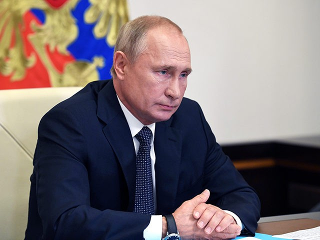 Russian President Vladimir Putin attends a cabinet meeting at the Novo-Ogaryovo residence outside Moscow, Russia, Tuesday, Aug. 11, 2020. Putin says that a coronavirus vaccine developed in the country has been registered for use and one of his daughters has already been inoculated. Speaking at a government meeting Tuesday, Aug. …