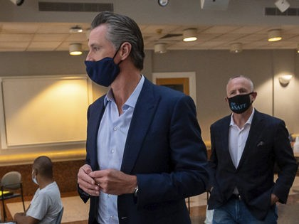 California Gov. Gavin Newsom, left, and Sacramento Mayor Darrell Steinberg tour a cooling center at the Tsakopoulos Library Galleria, Tuesday, Aug. 18, 2020, in Sacramento, Calif. Newsom declared an emergency Tuesday over wildfires burning throughout California as the state's power grid operator pleaded with residents and businesses to continue conserving …