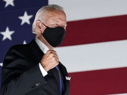 Democratic presidential candidate former Vice President Joe Biden pumps his fist on stage with his running mate Sen. Kamala Harris, D-Calif., during the fourth day of the Democratic National Convention, Thursday, Aug. 20, 2020, at the Chase Center in Wilmington, Del. (AP Photo/Andrew Harnik)