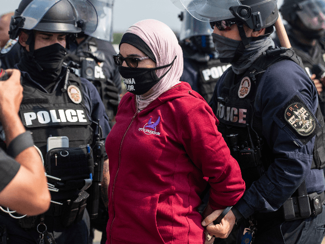 Linda Sarsour of Until Freedom is arrested near the University of Louisville on the final day of BreonnaCon, the