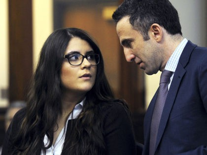 FILE- In this March 3, 2017 file photo, Nikki Yovino, left, appears with her attorney Mark Sherman as she is arraigned in Bridgeport Superior Court in Bridgeport, Conn., on charges that she lied about being raped by two Sacred Heart University football players. Yovino, who was sentenced to a year …