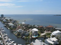 In this photo taken Saturday, May 23, 2015, shows Santa Rosa Sound and Pensacola Beach, Fla. While summer is the traditional down time for tourist resorts in hot and muggy South Florida, it is peak season 500 miles north in the beach towns of Florida's Panhandle. From St. George Island …