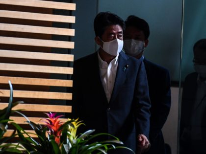 Japan's Prime Minister Shinzo Abe arrives at the Prime Minister's office in Tokyo on August 31, 2020. - Japan's Prime Minister Shinzo Abe announced on August 29 he will resign, ending his record-breaking tenure in a bombshell development that kicks off a leadership race in the world's third-largest economy. (Photo …