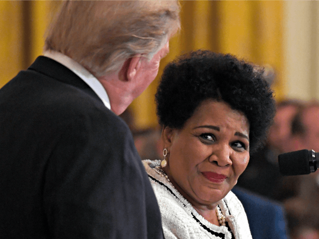 FILE - In this April 1, 2019, file photo President Donald Trump, left, listens as former prisoner Alice Marie Johnson, right, speaks at the 2019 Prison Reform Summit and First Step Act Celebration in the East Room of the White House in Washington. The 64-year-old African American great-grandmother spent 21 …