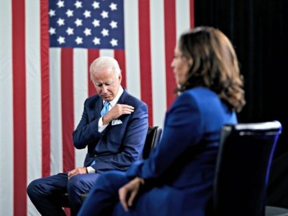 WILMINGTON, DE - AUGUST 12: Democratic presidential candidate former Vice President Joe Biden and his running mate Sen. Kamala Harris (D-CA) participate in a virtual fundraising event, in makeshift studio at the Hotel DuPont n August 12, 2020 in Wilmington, Delaware. Harris is the first Black woman and first person …