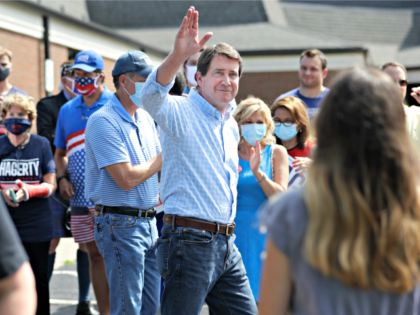 Former U.S. Ambassador to Japan Bill Hagerty waves to supporters at a polling place Thursday, Aug. 6, 2020, in Brentwood, Tenn. Hagerty and Dr. Manny Sethi are competing to become the GOP nominee in the race to replace retiring Republican Sen. Lamar Alexander. (AP Photo/Mark Humphrey)