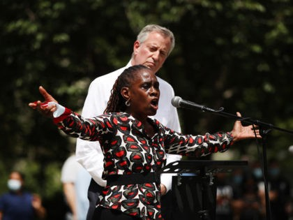 NEW YORK, NEW YORK - JUNE 04: New York Mayor Bill de Blasio listens as his wife, First Lady Chirlane McCray, speaks to an estimated 10,000 people as they gather in Brooklyn's Cadman Plaza Park for a memorial service for George Floyd, the man killed by a Minneapolis police officer …