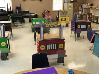 Two first-grade teachers decided to turn social distancing into something playful by turning the students' desks into mini Jeeps with plastic dividers.