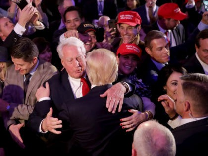 Republican president-elect Donald Trump hugs his brother Robert Trump after delivering his acceptance speech at the New York Hilton Midtown in the early morning hours of November 9, 2016 in New York City. Donald Trump defeated Democratic presidential nominee Hillary Clinton to become the 45th president of the United States. …