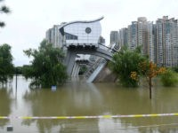 Flooded buildings are seen in Nanjing, in China's eastern Jiangsu province on July 19, 2020. - Vast swathes of China have been inundated by the worst flooding in decades along the mighty Yangtze River, with residents piling into boats and makeshift rafts to escape a deluge that has collapsed flood …