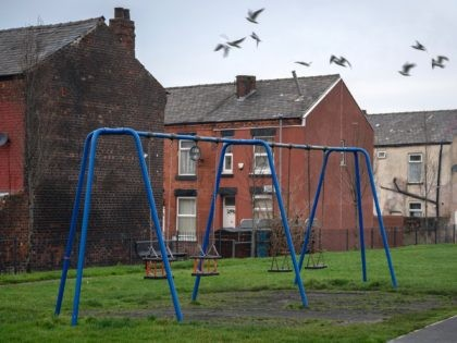 MANCHESTER, ENGLAND - DECEMBER 04: A children's play area sits next to terraced homes in the Gorton area of Manchester on December 04, 2018 in Manchester, England. A report by the Joseph Rowntree Foundation has claimed that over four million children are now living in poverty in the UK. The …